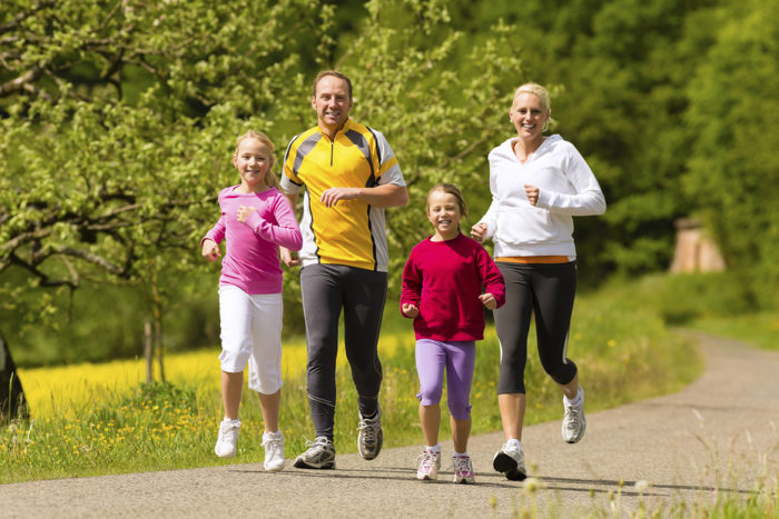 Family jogging for sport outdoors